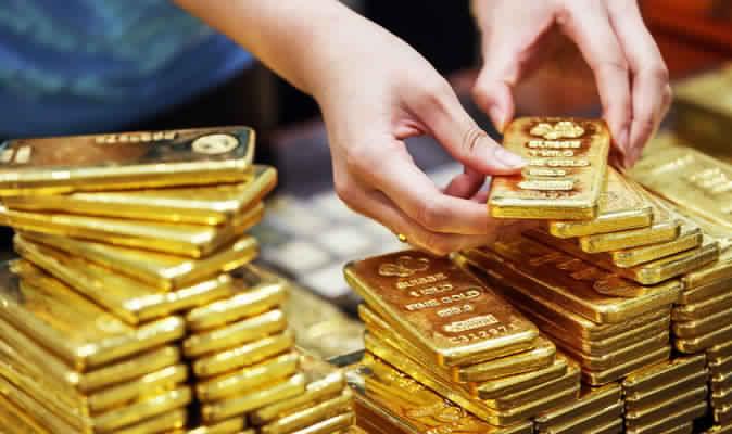 الذهب يحافظ على مكاسبه في نهاية الأسبوع مع استمرار الضبابية بشأن الاتفاق التجاري
