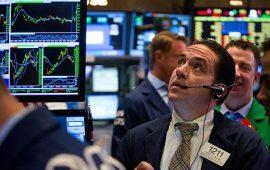 الأسهم الأمريكية تحقق مكاسب طفيفة بعد خفض سعر الفائدة
