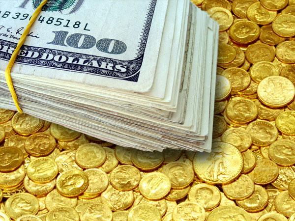 قوة الدولار تدفع أسعار الذهب لتهبط قرب أدنى مستوى في أسبوعين