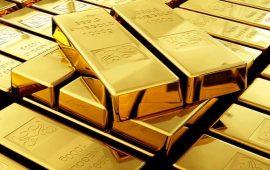 أسعار الذهب تنخفض إلى 1243 دولار وسط استمرار مكاسب الدولار